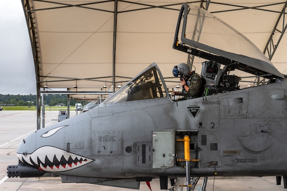 Maj. Adam Peterson, 74th Fighter Squadron (FS) A-10C Thunderbolt II pilot, adjusts his mask before departing for Jaded Thunder, Aug. 2, 2019, at Moody Air Force Base, Ga. Jaded Thunder is a joint services exercise to complete training requirements and prepare for future deployments. It includes joint forces integration by members of U.S. Air Force, Marine Corps, Navy and Army units, as well as representatives of the U.S. Special Operations Command. (U.S. Air Force photo by Airman 1st Class Hayden Legg)
