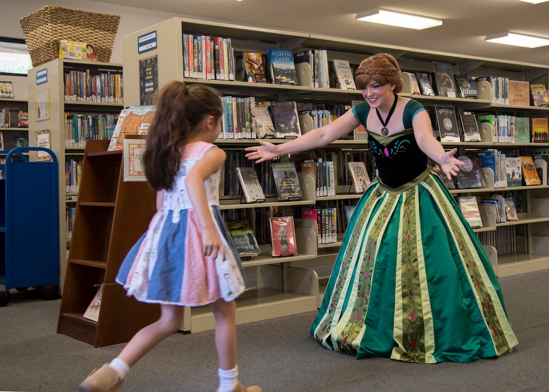Staff Sgt. Erica Darcy, 614th Air Operation Center intelligence analyst, welcomes a child during a children's book reading at a local library June 24, 2019, in Vandenberg Village, Calif.