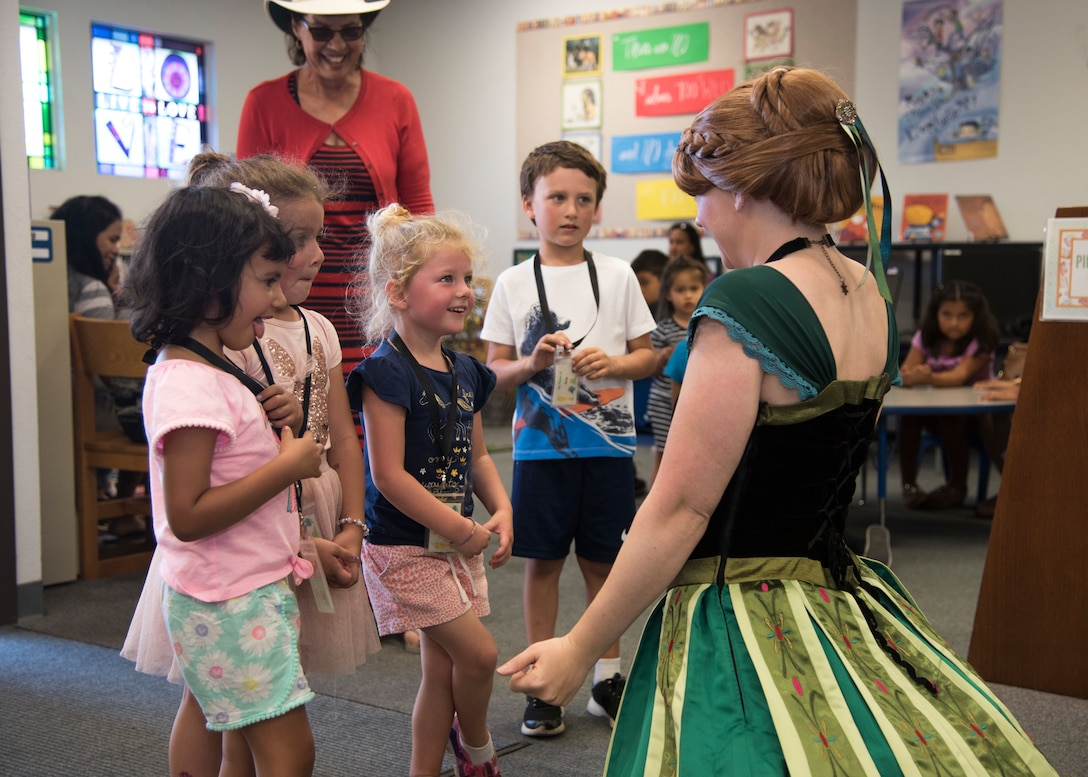 Staff Sgt. Erica Darcy, 614th Air Operation Center intelligence analyst, meets with children during a children's book reading at a local library June 24, 2019, in Vandenberg Village, Calif.