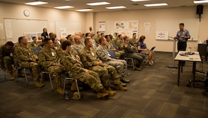Bob Krekel, Hawaii Electric Company Enterprise Performance Excellence-Execution director, highlights HECO continuous process improvement achievements to U.S. Air Force CPI Senior Leader Course participants at the HECO headquarters Aug. 2, 2019. The course is designed to teach senior leaders how to remove waste from process to better execute the Air Force mission. (U.S. Air Force photo by 2nd Lt. Amber R. Kelly-Herard)