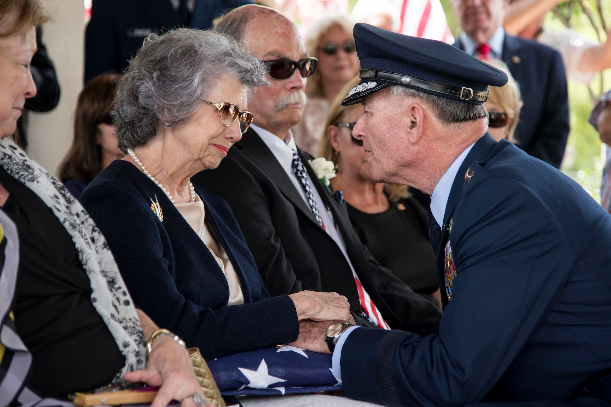 """Nancy (left), surviving wife of Oliver """"Ollie"""" Crawford, is presented the American flag by retired Lt. Gen. John Bradley Aug. 5, 2019, at Joint Base San Antonio-Fort Sam Houston, Texas. """"Ollie"""" passed away at the age of 94, on Sunday, July 21, 2019 in San Antonio, Texas."""