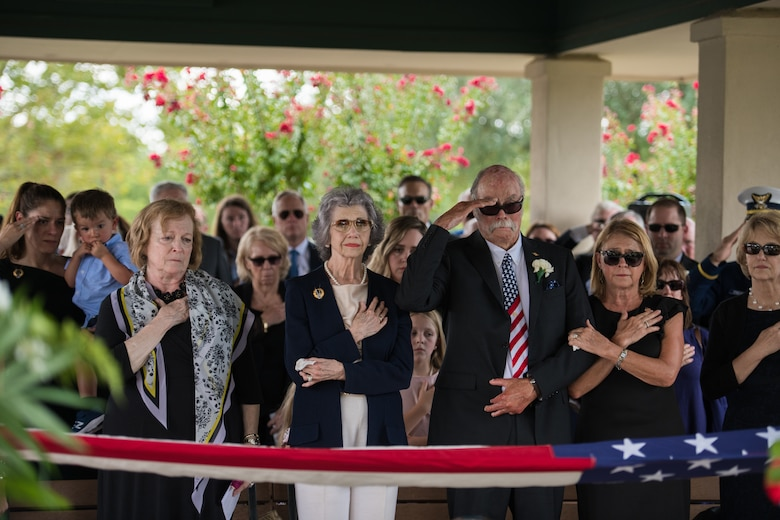 "Nancy (center), surviving wife of Oliver ""Ollie"" Crawford, places her hand over heart during her husband's funeral ceremony Aug. 5, 2019, at Joint Base San Antonio-Fort Sam Houston, Texas. ""Ollie"" passed away at the age of 94, on Sunday, July 21, 2019 in San Antonio, Texas."