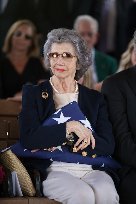 "Nancy, surviving wife of Oliver ""Ollie"" Crawford, holds on to the flag presented to her during her husband's funeral ceremony Aug. 5, 2019, at Joint Base San Antonio-Fort Sam Houston, Texas. ""Ollie"" passed away at the age of 94, on Sunday, July 21, 2019 in San Antonio, Texas."