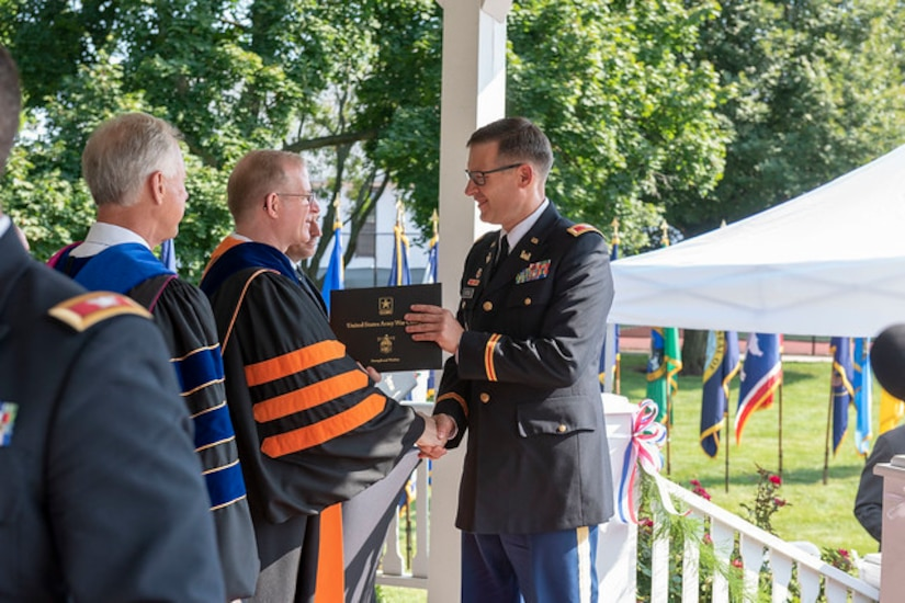 U.S. Army Reserve Col. Aaron Justice, commander of the 510th Regional Support Group, 7th Mission Support Command, receives his diploma during the U.S. Army War College class of 2019 graduation ceremony on Carlisle Barracks, Pennsylvania, July 26, 2019. Five 7th MSC officers graduated the two-year program with a Master's degree in Strategic Studies.