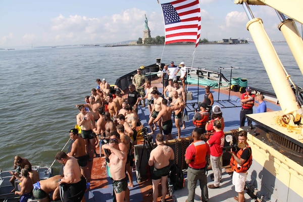 Assembled on the bow of the Army Corps vessel HAYWARD, 35 former and active members of the U.S. Navy SEAL during 'Hudson River Swim' charity event.