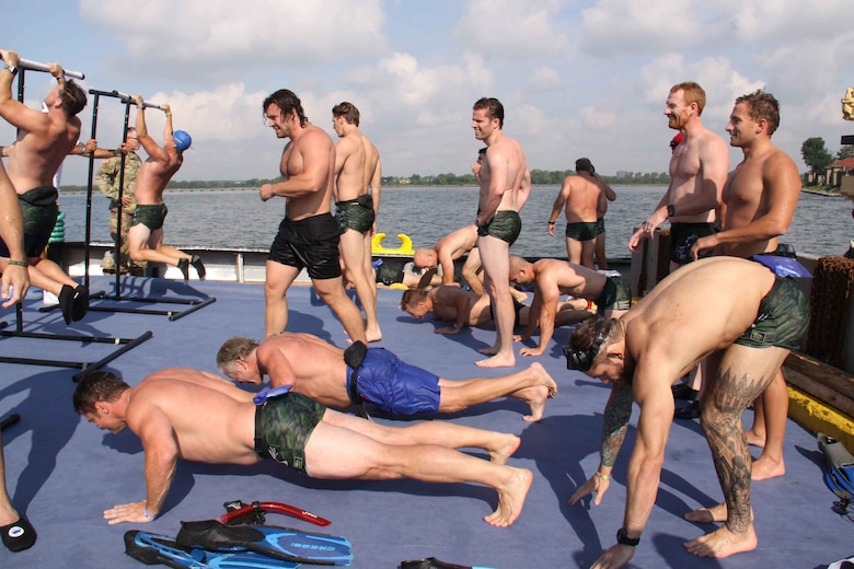 U.S. Navy SEALs perform pull ups and pushups on the stern of the HAYWARD during 'Hudson River Swim'
