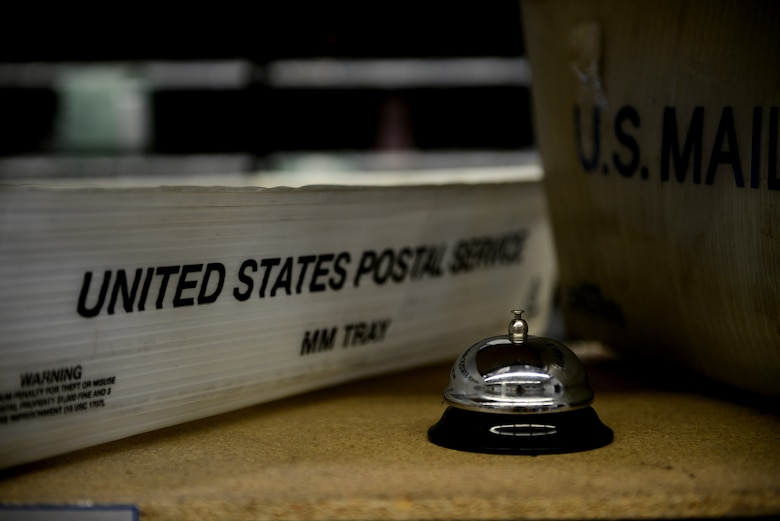 A call bell sits next to two United States postal service trays for help and service from the military postal clerks from the 31st Force Support Squadron Aug. 1, 2019, at Aviano Air Base, Italy. The 31st Force Support Squadron is the 31st Fighter Wing's largest and most diverse squadron, comprised of more than 600 military and civilian personnel whose primary mission is to enhance combat capability, readiness, and quality of life for a community of nearly 10,000 military members, DoD civilians, local national employees, and dependents. (U.S. Air Force photo by Airman 1st Class Ericka A. Woolever)