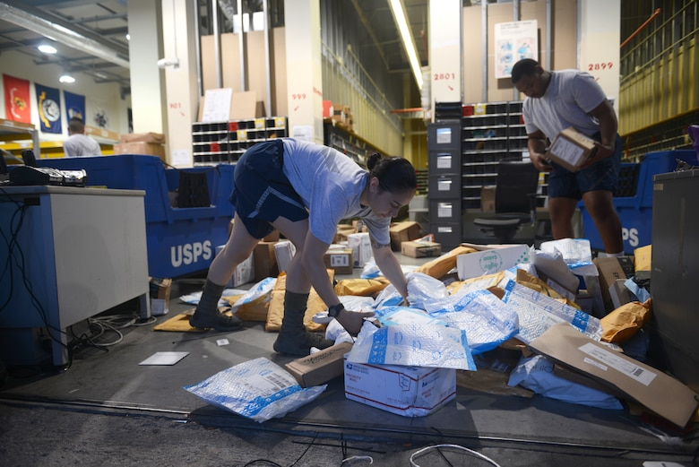 Airman 1st Class Selena Hernandez, a military postal clerk from the 31st Force Support Squadron, sorts packages from an early morning shipment, Aug. 2, 2019, at Aviano Air Base, Italy. Hernandez unloaded mail from a semi-truck that came in around five in the morning. (U.S. Air Force photo by Airman 1st Class Ericka A. Woolever)