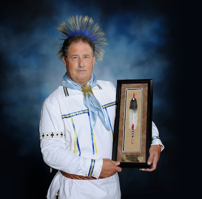 Edward Blauvelt poses in his American Indian regalia for a photo at the 502nd Air Base Wing public affairs office. Blauvelt was recently presented the 2019 Society of American Indians Government Employees Meritorious Service Award.