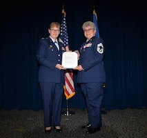Col. Lisa M. Craig, Air Force Reserve Command director of manpower, personnel, and services, presented the retirement order to Chief Master Sgt. Debra L. Kelly, 74th Aerial Port Squadron chief enlisted manager, upon the occasion of her retirement Aug. 3, 2019 at Joint Base San Antonio-Lackland, Texas.
