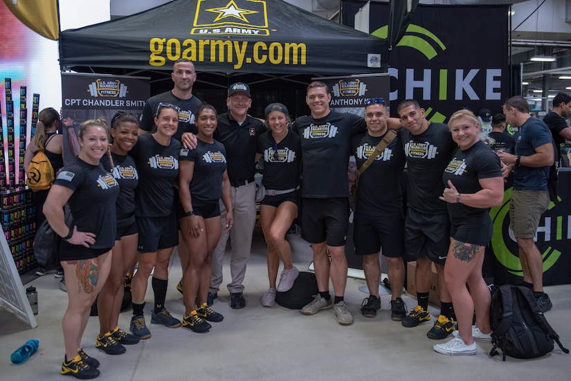 Members of the U.S. Army Warrior Fitness Team attended the 2019 CrossFit Games to support their teammates, Capt. Chandler Smith and Lt. Col. Anthony Kurz, participating in the event. During their visit, the team engaged with the fitness community to share the Army's story. In the photo, from left to right: Capt. Deanna Clegg, Capt. Kaci Clark, Capt. Allison Brager, First Sgt. Glenn Grabs, Capt. Ashley Shepard, Command Sgt. Major. Jan Vermeulen, Capt. Rachel Schreiber, Staff Sgt. Neil French, Spc. Jacob Pfaff, Sgt. 1st Class Carlos Zayas, Staff Sgt. Gabriele Burgholzer. (Photo Credit: Devon L. Suits)