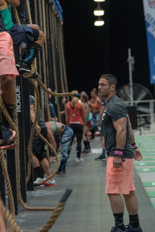 Lt. Col. Anthony Kurz, a member of the U.S. Army Warrior Fitness Team assigned to the Asymmetric Warfare Group in Fort Meade, Md., competes in the Men's Masters (40-44) Division at the 2019 CrossFit Games in Madison, Wis., Aug. 3, 2019. During his second event, Kurz had to complete three rope climbs 15 front squats, and 60 double-unders over five rounds for time. (Photo Credit: Devon L. Suits)