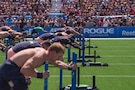 Capt. Chandler Smith, a member of the U.S. Warrior Fitness Team, competes in the men's individual competition at the 2019 CrossFit Games in Madison, Wis., Aug. 2, 2019. During the fourth round, Smith had to complete a 172-foot sled push, 18 bar muscle-ups, and another 172-foot sled push to the finish line in under six minutes. (Photo Credit: Devon L. Suits)