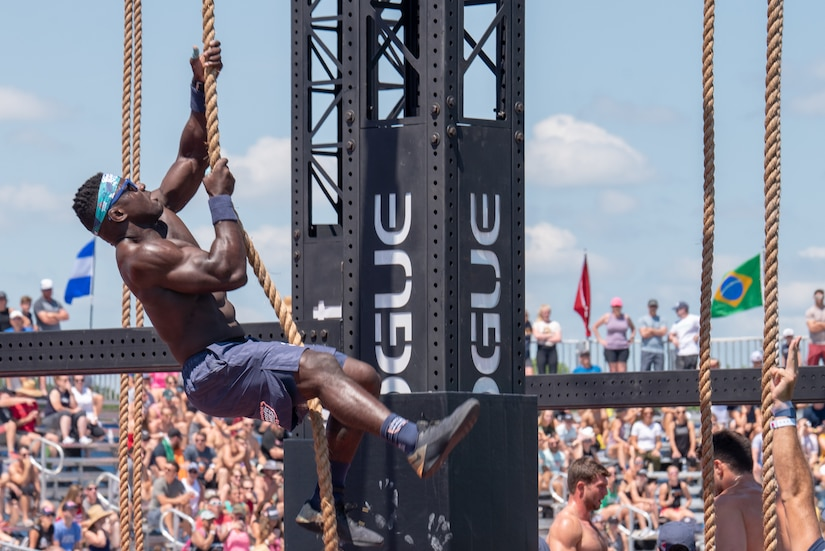 Capt. Chandler Smith, a member of the U.S. Warrior Fitness Team, competes in the men's individual competition at the 2019 CrossFit Games in Madison, Wis., Aug. 1, 2019. During the first workout of the day, Smith placed second overall and moved on to the next round of the competition. (Photo Credit: Devon L. Suits )