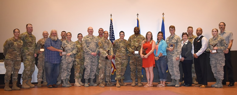 Col. Peter Bonetti, 90th Missile Wing commander, and Chief Master Sgt. Tiffany Bettisworth, 90th Missile Wing command chief, pose with the wing's second quarter award winners at F.E. Warren Air Force Base, Wyo., Aug. 2, 2019. The wing held a celebration for all the nominees and presented the awards to the winners during a ceremony. (U.S. Air Force photo by Glenn S. Robertson)