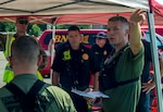 Members of the 61st Civil Support Team, Arkansas National Guard, brief their incident response plan to the West Licking Joint Fire District chief during Vigilant Guard 19-4, Aug. 5, 2019, at the Ohio Fire Academy in Reynoldsburg, Ohio. Vigilant Guard brings together over 3,000 personnel from more than 90 local, state and federal agencies to train and develop disaster response capabilities in the largest exercise of its kind in the state's history.