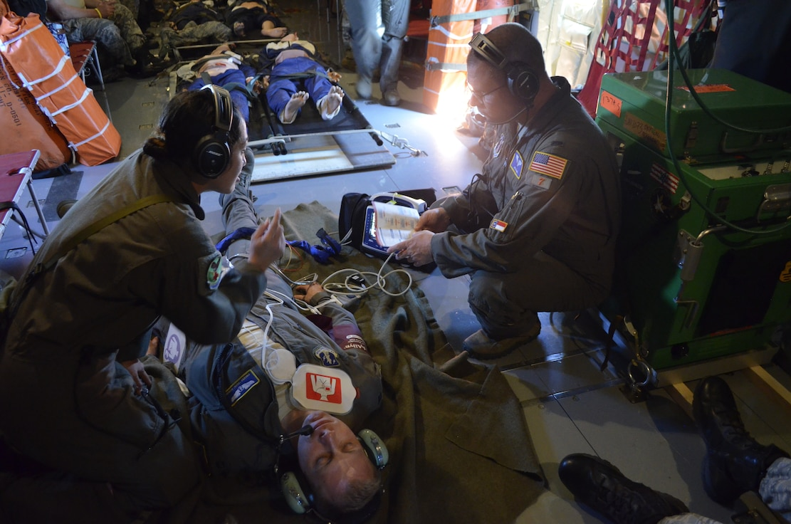 Senior Airman Kiara Rivera Cortes, an aeromedical evacuation technician, and 1st Lt. Jason Lail, flight nurse, both from the 156th Aeromedical Evacuation Squadron (AES), North Carolina Air National Guard, respond to a patient as part of an exercise evaluation, mid-flight on a 171st Air Refueling Squadron, Michigan Air National Guard, KC-135 Stratotanker, July 30, 2019. Cortes and Lail are part of a joint Air National Guard medical team involving seven states during the Northern Strike 19 exercise. Northern Strike 19 is a National Guard Bureau-sponsored exercise uniting approximately 5,700 service members and more than 20 states and seven coalition countries at the Camp Grayling Joint Maneuver Training Center and the Alpena CRTC, both located in Northern Michigan. (U.S. Air National Guard photo by Capt. Anthony J. Lesterson)