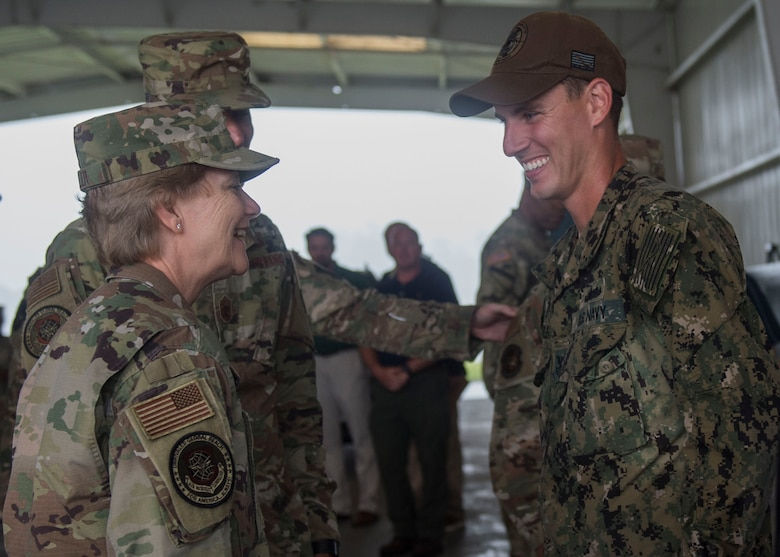 Gen. Maryanne Miller, left, commander of Air Mobility Command, coins a Sailor during a visit to Joint Base Charleston Naval Weapons Station, South Carolina, July 30, 2019. Miller visited JB Charleston July 29 to August 1 to get a first-hand look at mission capabilities, new innovative programs and how JB Charleston is taking care of its service members to build a stronger mobility force. Joint Base Charleston is one of 12 Department of Defense Joint Bases and host to over 60 DOD and Federal agencies. Naval Munitions Command provides quality and responsible ordnance material handling, and technical and material support to the Fleet and other customers in the areas of retail ammunition management. The command also maintains and operate explosive ordnance outboarding and transshipment facilities.