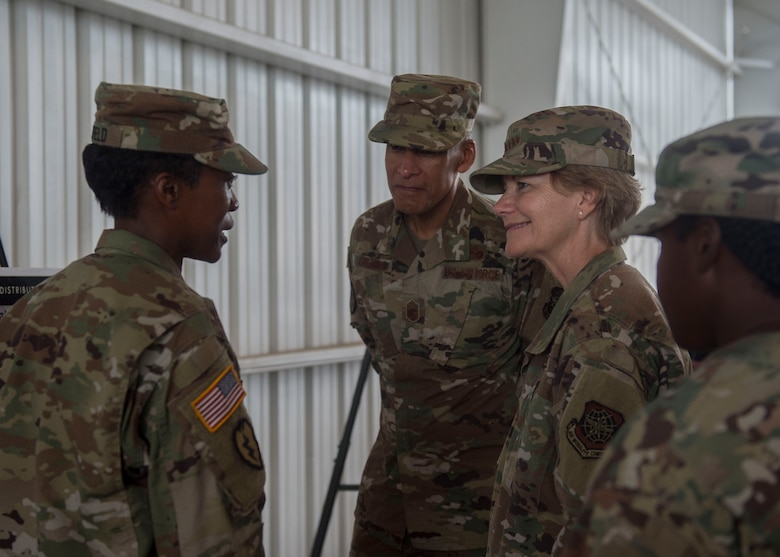 U.S. Army Lt. Col. Altwan Whitfield, left, commander of the 841st Transportation Battalion, gives a mission brief to Gen. Maryanne Miller, right, commander of Air Mobility Command, and Chief Master Sgt. Terrence Greene, AMC command chief master sergeant, center, during a visit to the Joint Base Charleston Naval Weapons Station, South Carolina, July 30, 2019. Miller and Greene visited JB Charleston July 29 to August 1 to get a first-hand look at mission capabilities, new innovative programs and how JB Charleston is taking care of its service members to build a stronger mobility force.  The 841st Trans. Bn.  conducts surface distribution and port clearance operations in support of combatant commanders and deployment readiness.