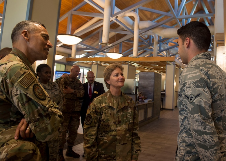 Airman Skyler Locklear, right, assigned to the 628th Force Support Squadron, meets Gen. Maryanne Miller, center, commander of Air Mobility Command, and Chief Master Sgt. Terrence Greene, AMC command chief master sergeant, during a tour of the Gaylor Dining Facility at Joint Base Charleston, South Carolina, July 30, 2019. Miller and Greene visited JB Charleston July 29 to August 1 to get a first-hand look at mission capabilities, new innovative programs and how JB Charleston is taking care of its service members to build a stronger mobility force.  The dining facility re-opened February 2019 after a two-year renovation. The renovations help dining facility personnel adjust to changing dietary needs and preferences, and improves efficiency and reduces costs while maintaining mission feeding capabilities.