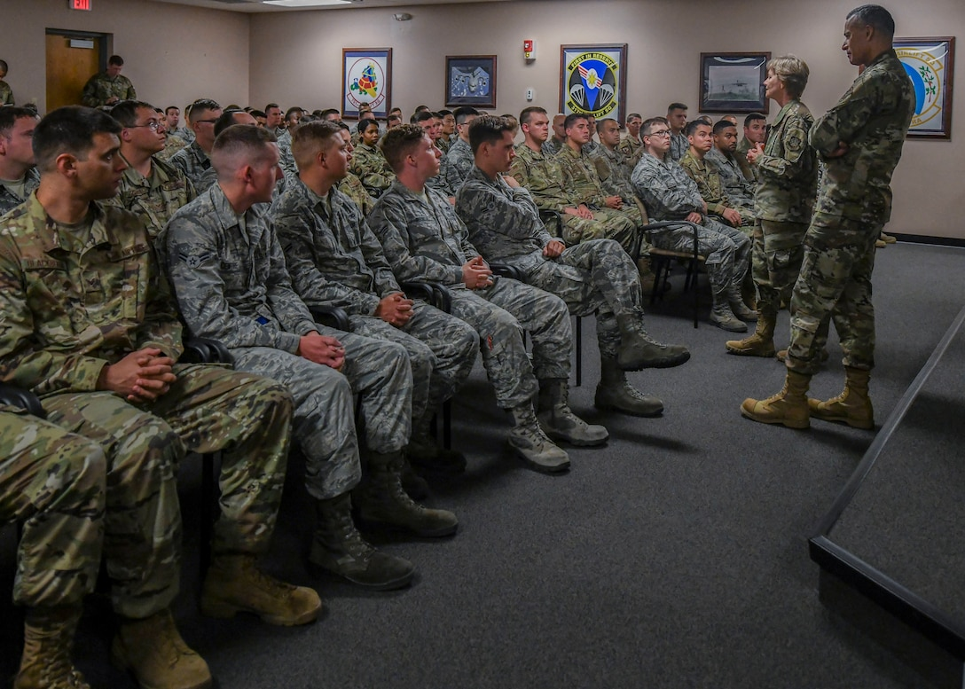 Gen. Maryanne Miller, commander of Air Mobility Command, and Chief Master Sgt. Terrence Greene, AMC command chief master sergeant, speak to junior enlisted members of the 437th Maintenance Group during a visit to Joint Base Charleston, South Carolina, July 31, 2019. Miller and Greene visited JB Charleston July 29 to August 1 to get a first-hand look at mission capabilities, new innovative programs and how JB Charleston is taking care of its service members to build a stronger mobility force.  New innovative programs being implemented on base include a summer intern program, a centralized fitness improvement program and a Child Development Center program to expand infant care options, as well as other programs to help improve quality of life and retain service members.