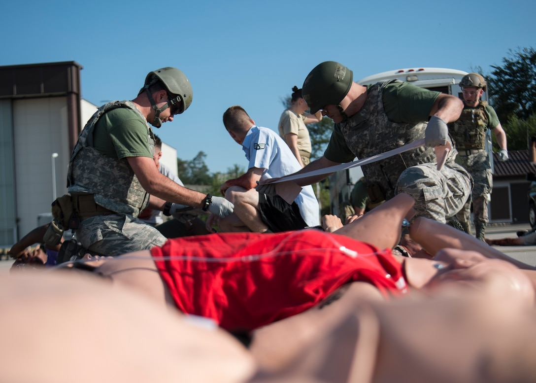 Medics respond to a simulated mass casualty scenario during the U.S. Air Forces in Europe EMT Rodeo at Ramstein Air Base, Germany, July 24, 2019. The EMT Rodeo consisted of teams from across Europe including, Incirlik AB, Turkey, Aviano AB, Italy, Royal Air Force Lakenheath, England, RAF Croughton, England, RAF Alconbury, England, Spangdahlem AB, Germany, and Landstuhl Regional Medical Center, Germany. (U.S. Air Force photo by Staff Sgt. Kirby Turbak)