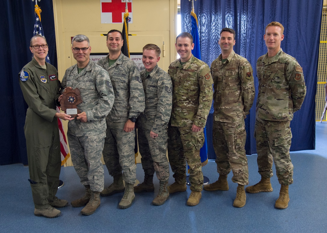 Members of the 48th Medical Group from Royal Air Base Lakenheath, England receive the U.S. Air Forces in Europe EMT Rodeo trophy at Ramstein Air Base, Germany, July 25, 2019. Teams were judged on how accurate and quickly they provided medical attention. (U.S. Air Force photo by Staff Sgt. Kirby Turbak)