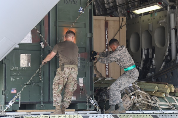 A Soldier with Task Force-51 and an Airman with the 502nd Logistics Readiness Squadron load equipment on a C-17 Globemaster III cargo plane in preparation to support exercise Vigilant Guard-Ohio at Joint Base San Antonio-Kelly Field Annex in San Antonio Aug 4. VG-Ohio is held by U.S. Northern Command and the National Guard Bureau that will test the state's emergency response capabilities with a simulated attack.