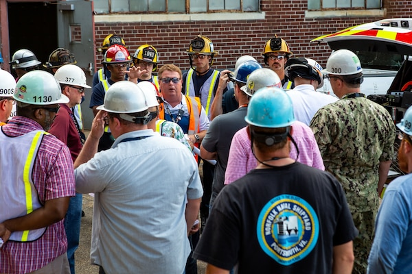 City of Chesapeake firefighters tour USS George H.W. Bush (CVN 77) at Norfolk Naval Shipyard (NNSY) July 25, helping to better understand the shipyard's waterfront layout, emergency scene operations and carrier confines in the event of a major fire shipboard.  Bush is currently at NNSY undergoing a Drydocking Planned Incremental Availability (DPIA).