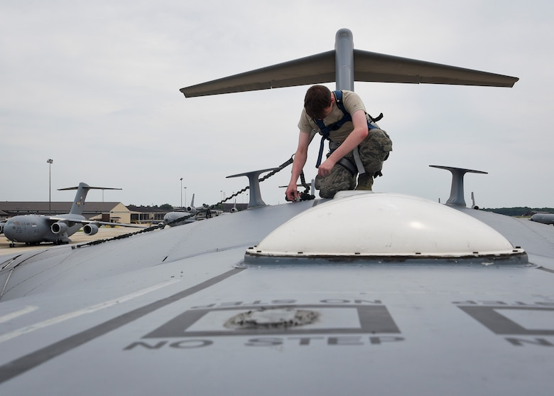 U.S. Air Force Airman 1st Class Chase Marlow, 305th Aircraft Maintenance Squadron crew chief, inspects a C-17 Globemaster to ensure there are no discrepancies prior to take-off at Joint Base McGuire-Dix-Lakehurst, New Jersey, August 2, 2019. Crew chiefs are able to maintain aircraft, support equipment, forms and records. (U.S. Air Force photo by Airman 1st Class Briana Cespedes)