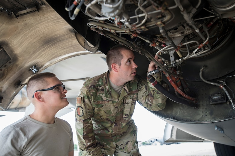 U.S. Air Force Senior Airman Joshua Bridges and U.S. Air Force Airman 1st Class Nathaniel Canfield, 305th Aircraft Maintenance Squadron jet engine mechanics, troubleshoot a part inside of a C-17 Globemaster engine during maintenance checks August 2, 2019 on Joint Base McGuire-Dix-Lakehurst, New Jersey. Responsible for ensuring that all plane's engines are in first-rate operational conditions, jet engine mechanics test, maintain and repair all parts of the engine. (U.S. Air Force photo by Senior Airman Jake Carter)