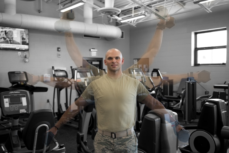 Airman 1st Class Adam Schuck, a services specialist with the 193rd Special Operations Force Support Squadron, Pennsylvania Air National Guard, performs a shoulder exercise
