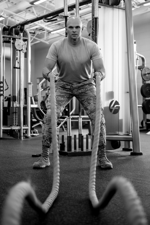 Airman 1st Class Adam Schuck, a services specialist with the 193rd Special Operations Force Support Squadron, Pennsylvania Air National Guard, works out with battle ropes