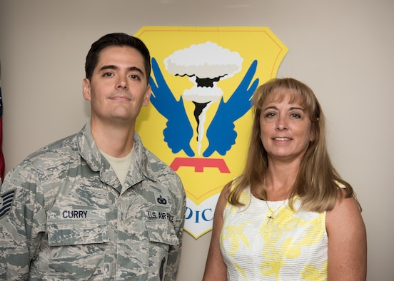 Second Lt. Christina Renkoski, a nurse with the U.S. Air Force Nurse Corps poses for a photo with her recruiter, Tech. Sgt. Mark Curry on July 22, 2019, at the 509th Medical Group Clinic at Whiteman Air Force Base, Missouri. Curry, an Air Force health professions recruiter with the 342nd Recruiting Squadron from Overland Park, Kansas, assisted Renkoski throughout her process to join the Air Force and rendered the first salute of her career. (U.S. Air Force Photo by Airman 1st Class Parker J. McCauley)