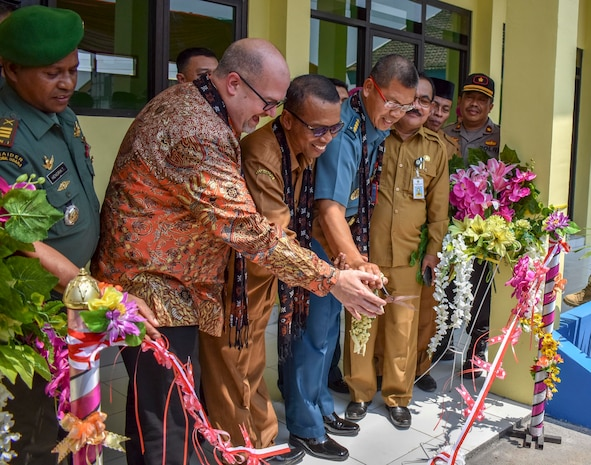 GRESIK DISTRICT, Indonesia (Aug. 5, 2019) Mark McGovern, U.S. Consul General in Surabaya, Indonesia, Dr. Sambari Halim Radianto, head of Gresik District Government, and Indonesian Navy Kolonel Laut Eka Prabawa, assistant for maritime potential, cut a ribbon to mark the completion of a construction project at the SDN Duduk Sampeyan Elementary School during Cooperation Afloat Readiness and Training (CARAT) Indonesia 2019. During the project, U.S. Navy Seabees assigned to Naval Mobile Construction Battalion 4 and Indonesian Marines assigned to the 2nd Engineering Battalion built a two-room classroom wired to support 20 computers. This year marks the 25th iteration of CARAT, a multinational exercise designed to enhance U.S. and partner navies' abilities to operate together in response to traditional and non-traditional maritime security challenges in the Indo-Pacific region. (U.S. Navy photo by Steelworker 2nd Class Candace Lightsey)