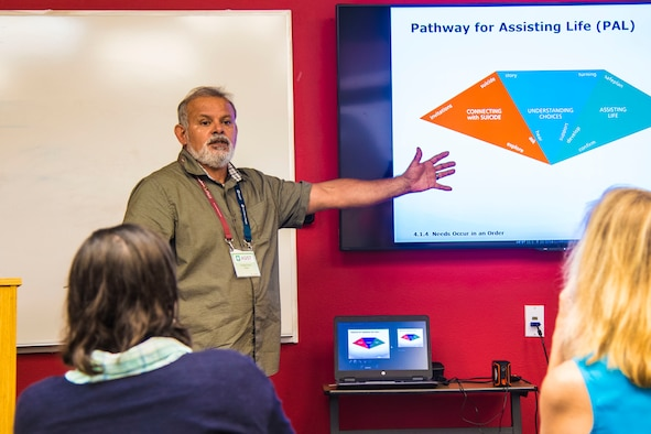 Armando O. Franco, wellness team lead, Air Force Wounded Warrior Program, instructs unit and service members during an Applied Suicide Intervention Skills Training session, July 31, 2019, Joint Base San Antonio-Randolph. The training is a two-day interactive workshop that teaches suicide first-aid initiatives.