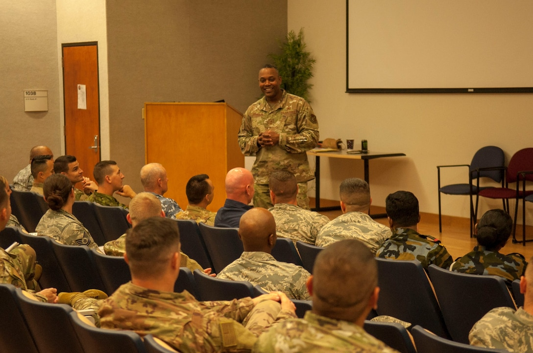 Chief Master Sgt. Anthony Johnson, U.S. Pacific Air Forces command chief, speaks to Airmen and international partners during a First Sergeants Symposium at Joint Base Pearl Harbor-Hickam, Hawaii, July 24, 2019. The five-day course included training provided by Air University, the First Sergeant Academy, and informational briefings from base helping agencies. 
