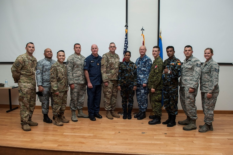 U.S. Air Force Airmen pose for a picture with international service members during a First Sergeants Symposium at Joint Base Pearl Harbor-Hickam, Hawaii, July 24, 2019. The five-day course included training provided by Air University, the First Sergeant Academy, and informational briefings from base helping agencies. Service members from Sri Lanka, Australia, New Zealand, and the Philippines participated in the symposium. (U.S. Air Force photo by Staff Sgt. Mikaley Kline)