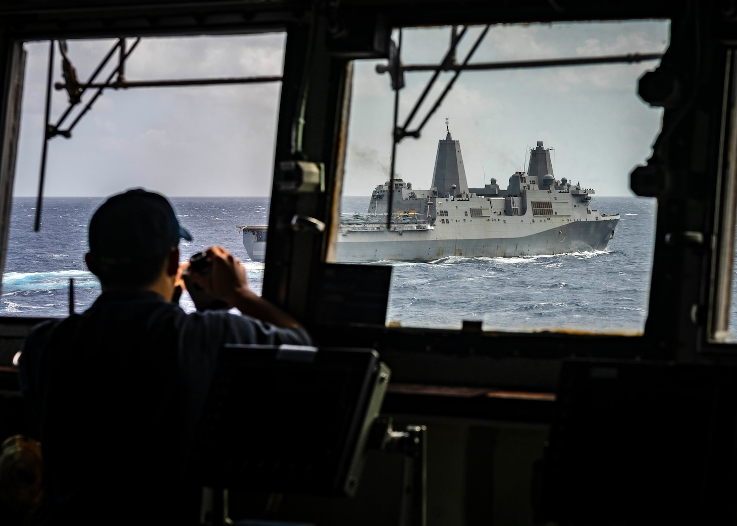 CORAL SEA (August 01, 2019) – The amphibious dock landing ship USS Ashland (LSD 48) sails alongside the amphibious transport dock ship USS Green Bay (LPD 20). Ashland, part of the Wasp Amphibious Ready Group, with embarked 31st Marine Expeditionary Unit, is operating in the Indo-Pacific region to enhance interoperability with partners and serve as a ready-response force for any type of contingency.