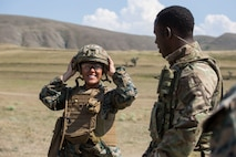 A U.S. Marine with Marine Rotational Force-Europe 19.2, Marine Forces Europe and Africa tries on a U.K. Army Kevlar during exercise Agile Spirit 2019 in Orpholo, Georgia, July 31, 2019.