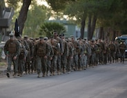 U.S. Marines with the logistics combat element of Special Purpose Marine Air-Ground Task Force-Crisis Response-Africa 19.2, Marine Forces Europe and Africa, conduct a 5 mile conditioning hike at Naval Air Station Sigonella, Italy, Aug. 3, 2019.