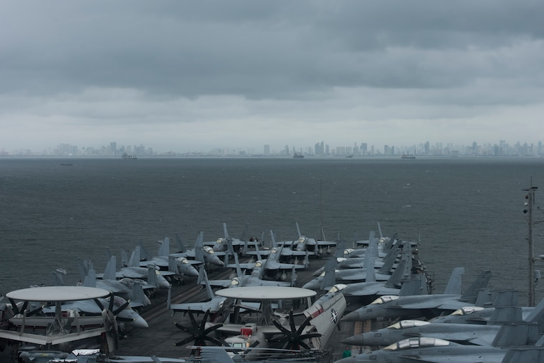 MANILA, Philippines (August 9, 2019) The aircraft carrier USS Ronald Reagan (CVN 76) anchors outside Manila, Philippines. Ronald Reagan is forward-deployed to the U.S. 7th Fleet area of operations in support of security and stability in the Indo-Pacific region.