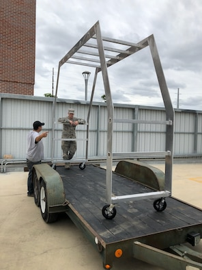Wichita State University GoCreate Lab members, secure the KC-46A Pegasus Cargo Validation Tool prototype to be moved to McConnell Air Force Base, Kan., May 29, 2019. The validation tool will help aerial porters ensure cargo that is planning to be loaded, will fit inside a KC-46 fuselage without the aircraft present. (Courtesy photo)