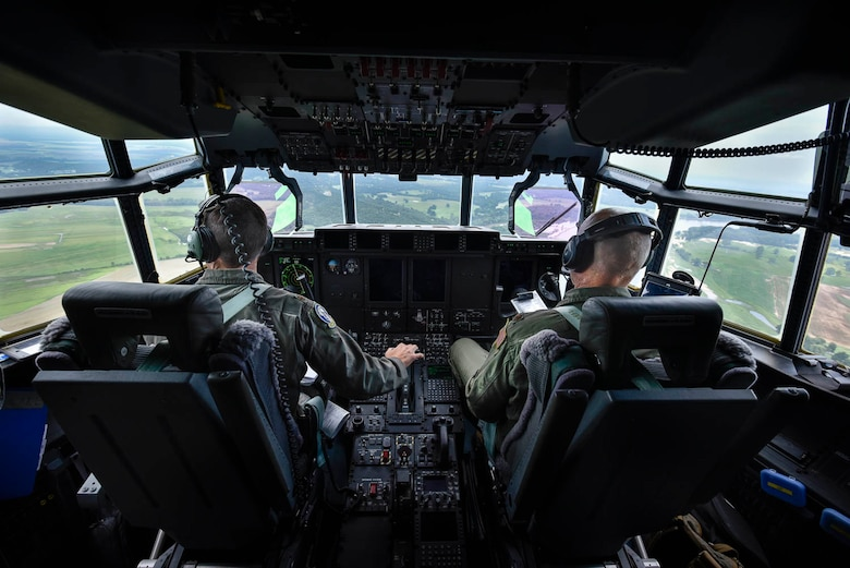 Maj. Seth Lake, 327th Airlift Squadron pilot, and Maj. Maj. Matthew Heisel, 327th Airlift Squadron pilot, participate in a training flight to enhance readiness on August 3, 2019, at Little Rock Air Force Base, Ark. The C-130 is a versatile aircraft that can be used for several different missions and the success of the mission depends upon teamwork and Airmen's resiliency and their ability to overcome adversity. (U.S. Air Force photo by Senior Airman Nathan Byrnes)