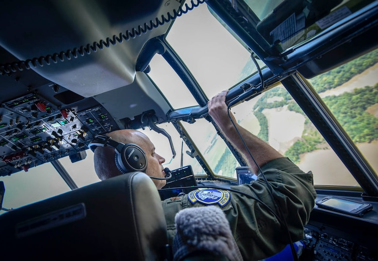 Maj. Maj. Matthew Heisel, 327th Airlift Squadron pilot, participate in a training flight to enhance readiness on August 3, 2019, at Little Rock Air Force Base, Ark. The C-130 is a versatile aircraft that can be used for several different missions and the success of the mission depends upon teamwork and Airmen's resiliency and their ability to overcome adversity. (U.S. Air Force photo by Senior Airman Nathan Byrnes)