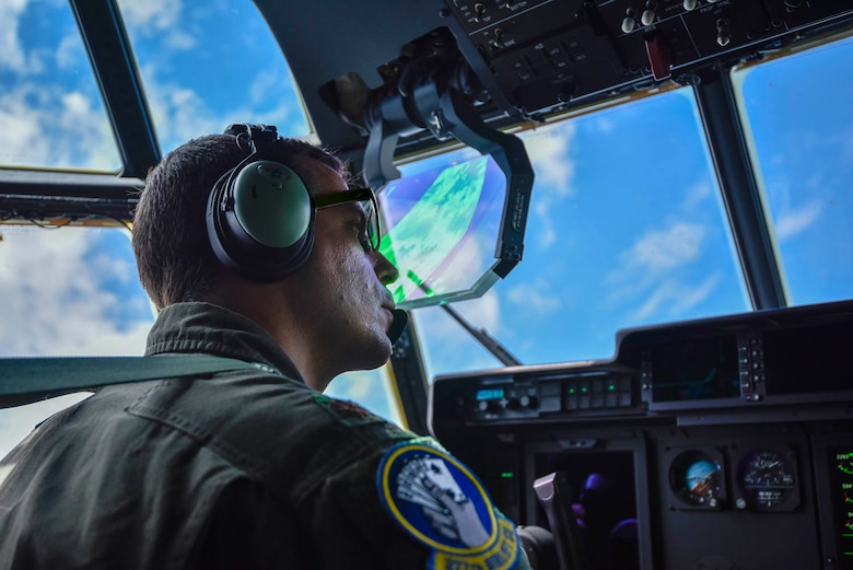 Maj. Seth Lake, 327th Airlift Squadron pilot, participates in a training flight to enhance readiness on August 3, 2019, at Little Rock Air Force Base, Ark. The C-130 is a versatile aircraft that can be used for several different missions and the success of the mission depends upon teamwork and Airmen's resiliency and their ability to overcome adversity. (U.S. Air Force photo by Senior Airman Nathan Byrnes)