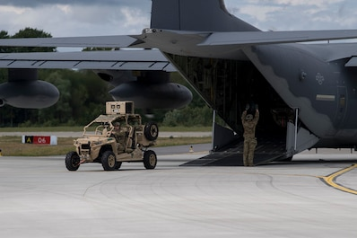 U.S. Air Force Special Tactics Operators offload tactical vehicles from an MC-130J Commando II to conduct a forward arming and refueling point mission with USAFE aircraft during Operation Rapid Forge at Ämari Air Base, Estonia, July 16, 2019. Special Tactics is a U.S. Special Operation Command's tactical air and ground integration force, and the Air Force's special operations ground force, leading Global Access, Precision Strike, Personnel Recovery and Battlefield Surgery operations on the battlefield. The MC-130J Commando II, and aircrew, are able to execute refueling missions in austere, sensitive or hostile territories. Operation Rapid Forge involves NATO territories in order to enhance readiness and improve interoperability between U.S. allies and partners in Europe. (U.S. Air Force photo by Staff Sgt. Rose Gudex)