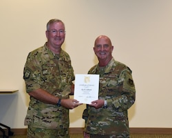 Col. Jeffery Van Dootingh, 403rd Wing commander, presented Col. Jay Johnson, 403rd Maintenance Group commander, with his 10-year service certificate as an Air Reserve Technician, Aug. 6, 2019 at the Roberts Consolidated Maintenance Facility Auditorium, Keesler Air Force Base, Mississippi.  Van Dootingh held his first civilian commanders call, where he presented service certificates and welcomed new members to the 403rd Wing. (U.S. Air Force photo by Jessica L. Kendziorek)