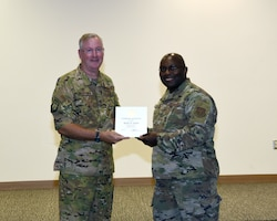 Col. Jeffery Van Dootingh, 403rd Wing commander, presented Tech. Sgt. Kenric Graves, 403rd Maintenance Squadron, with his 20-year service certificate as an Air Reserve Technician, Aug. 6, 2019 at the Roberts Consolidated Maintenance Facility Auditorium, Keesler Air Force Base, Mississippi.  Van Dootingh held his first civilian commanders call, where he presented service certificates and welcomed new members to the 403rd Wing. (U.S. Air Force photo by Jessica L. Kendziorek)