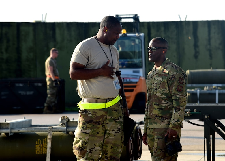 Brig. Gen. Ronald E. Jolly, Director of Logistics, Engineering and Force Protection, Headquarters U.S. Air Forces in Europe-Air Forces Africa, Ramstein Air Base, Germany, is briefed by an Airman during Combat Ammunition Production Exercise 2019 on Aug. 7, 2019, at Aviano Air Base, Italy. USAFE is engaged, postured and ready with credible force to deter adversaries and defend European allies and partners against malign forces in an increasingly complex security environment. (U.S. Air Force photo by Airman 1st Class Caleb House)